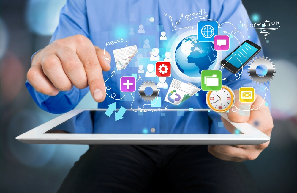 Man selecting social media icons over a tablet